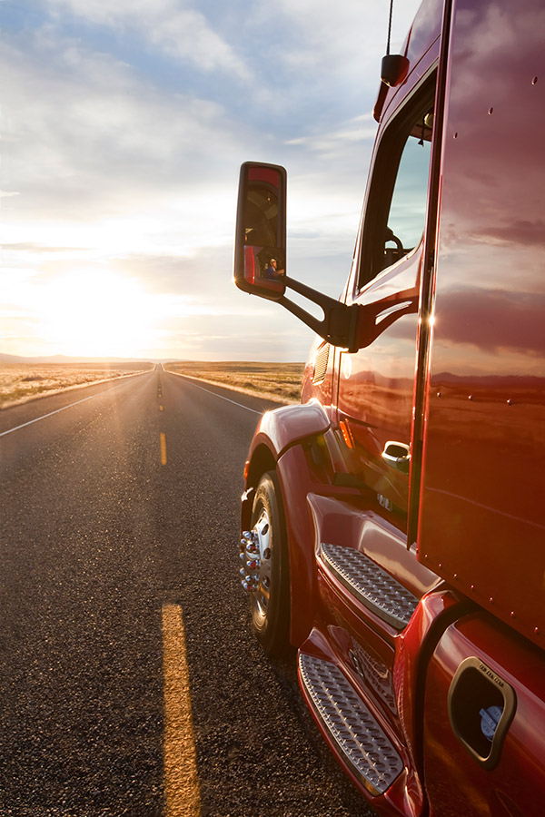 Peterbilt Truck Driving into the sunset.
